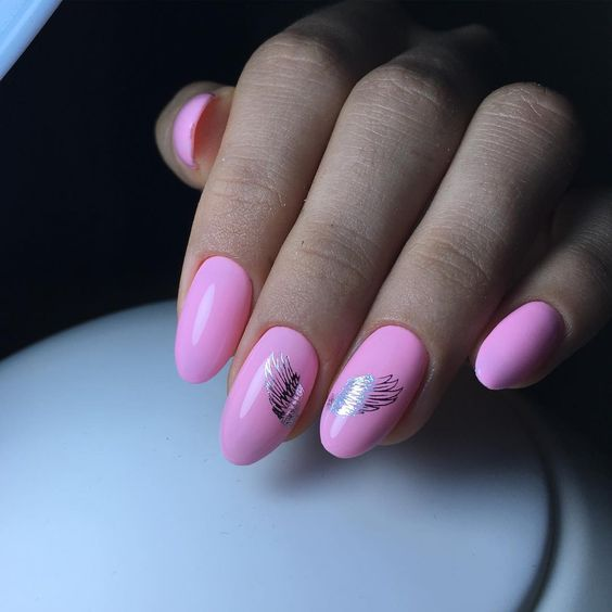 pink nail design with angels wings