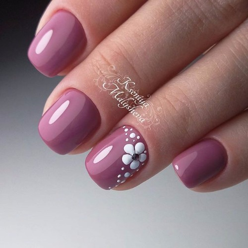 dark pink nails with flower design