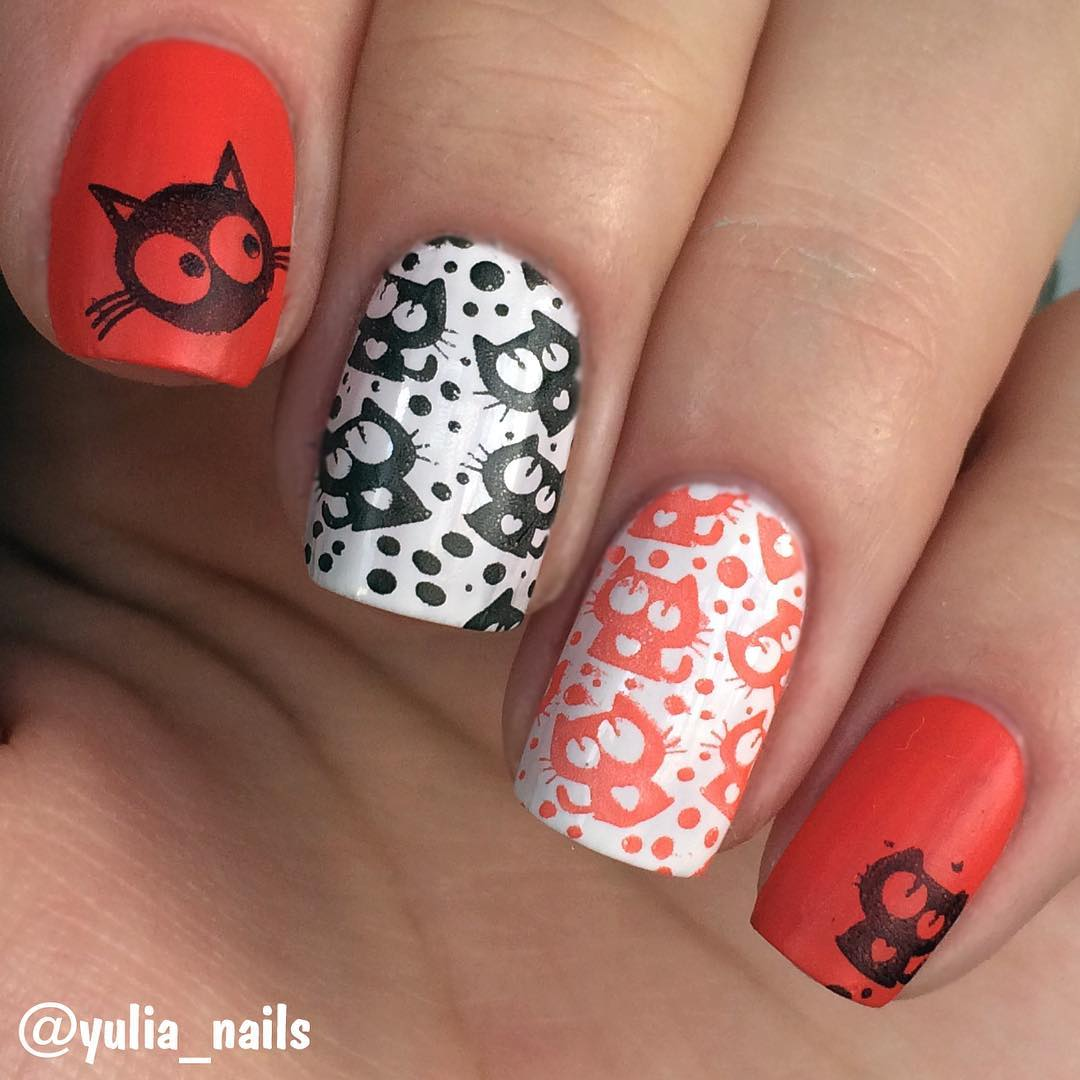 white and red nail design with cats