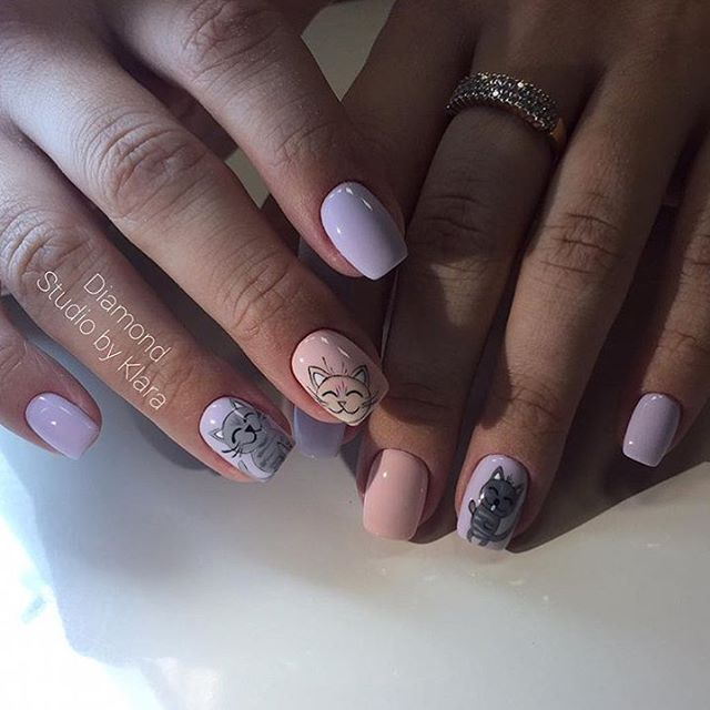 purplish rosy manicure with cats
