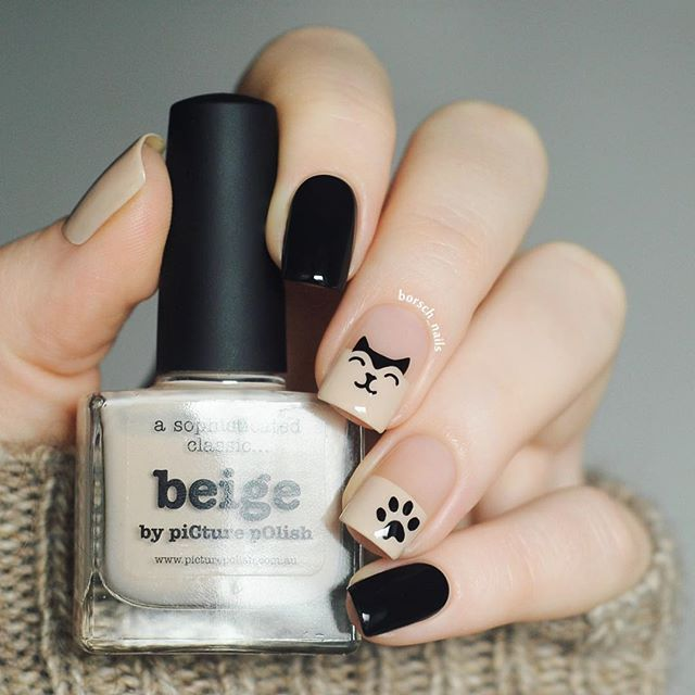 nude and black nail design with cats