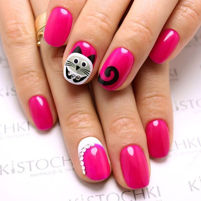 pink nail art with kittens
