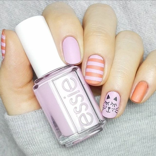pastel nails with stripes and cat design