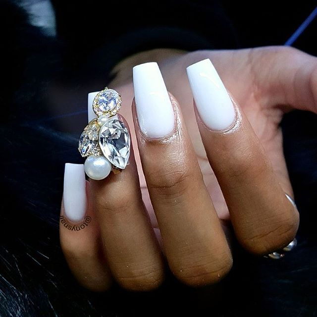 white manicure with big gemstones