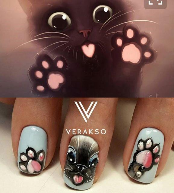 черный котенок с розовыми подушечками на лапах маникюр