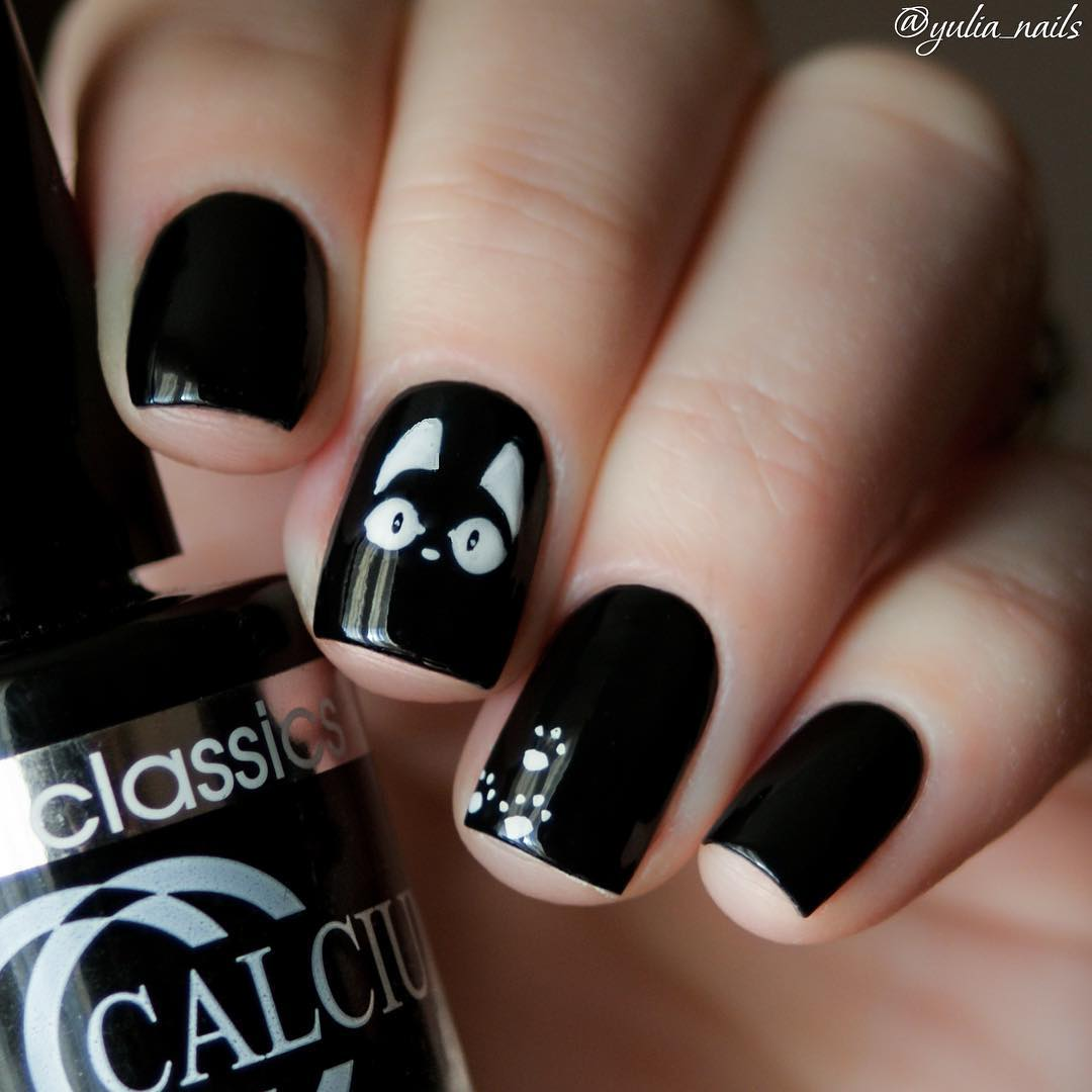black nail design with white cats