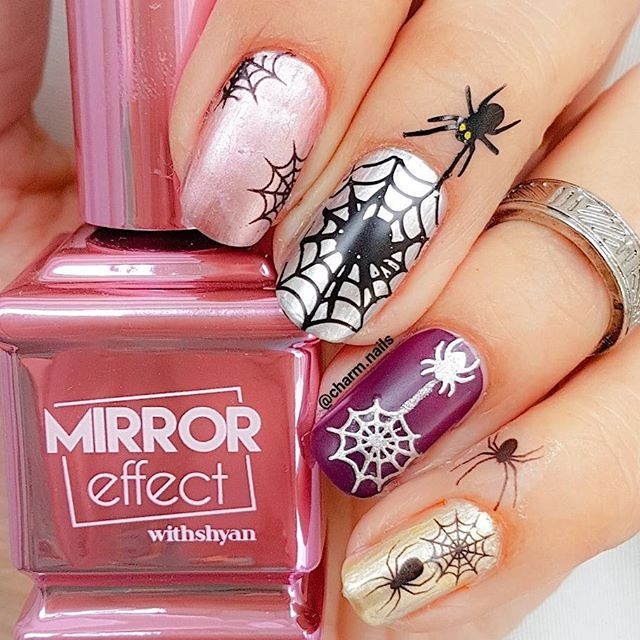 white and purple spider Halloween nails