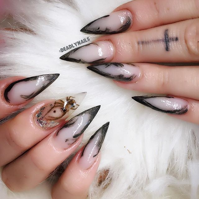 Halloween nails with a dead spider
