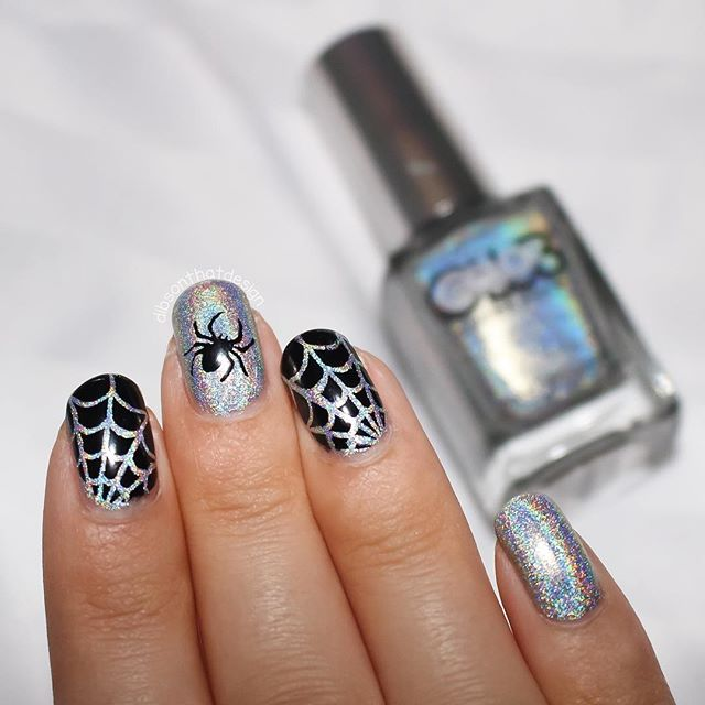 black and silver glitter nail art spider web