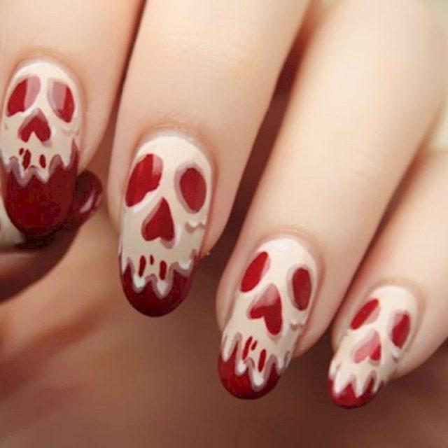 маникюр на хэллоуин красный с костяным черепом