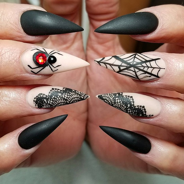 black and nude beige spider web design on nails