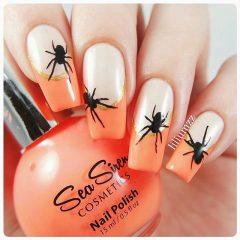 Оранжевый французский маникюр с пауками на Хэллоуин