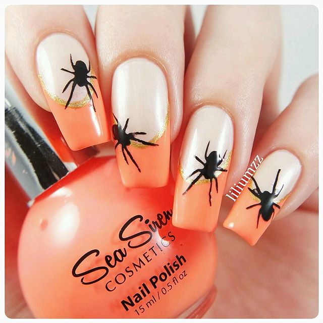 orange French nail design with spiders