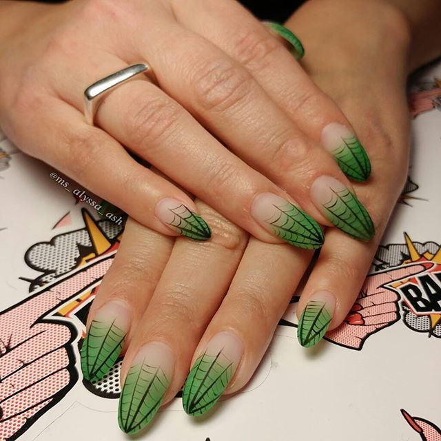 long spider web nail art design with green spider web