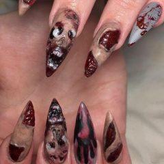 ногти с кровавыми существами и ранами