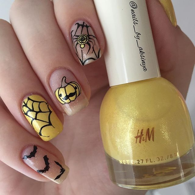 yellow spider web design for nails