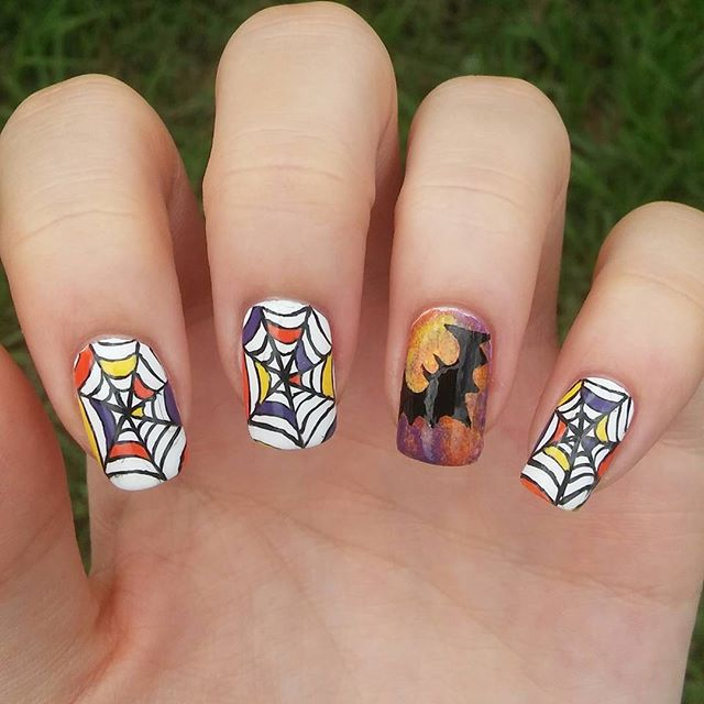 bat and spider design on nails