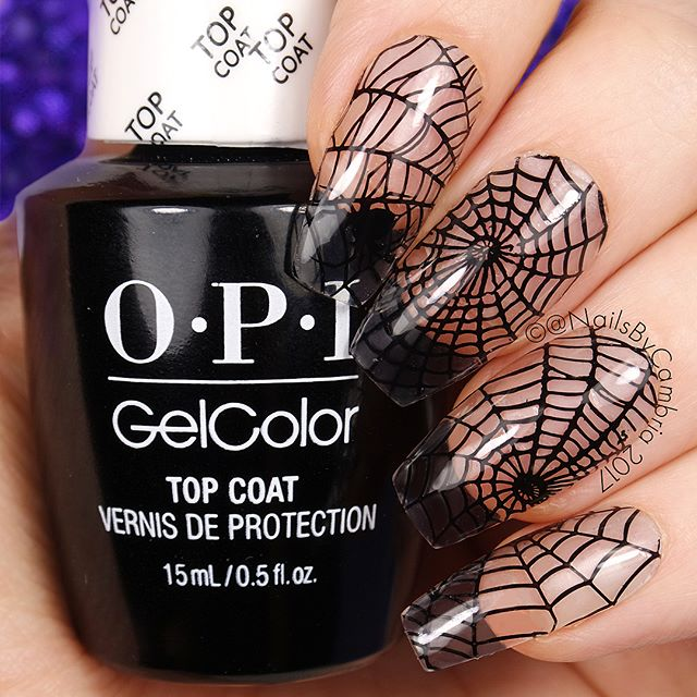 clear Halloween nails with black spider web