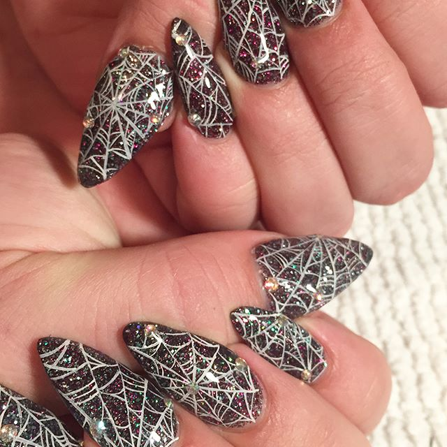 gray glittering spider web nails