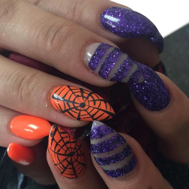 purple and orange spider web nail design