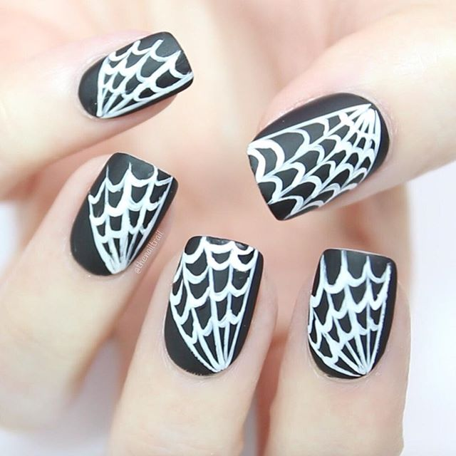 black nails with white spider web
